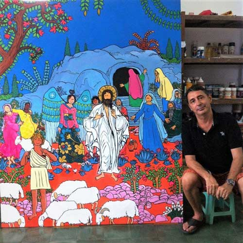 Stef beside one of his paintings